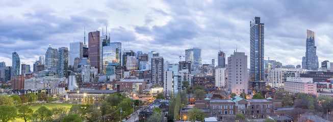 Toronto Financial District skyscrapers and the CN Tower apex at the background at twilight- panoramic