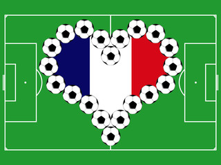 Soccer balls as the heart in colors of the flag of France on the playing field
