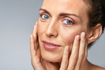 skin care with middle age woman in studio