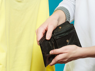 Human with empty wallet purse. Lack of money.