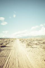 Poster de jardin Desert de sable High desert dirt road