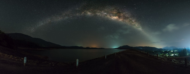 Panorama view of milky way galaxy over the dam