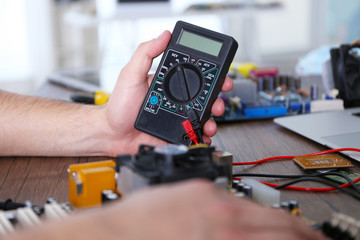 Male hands checking electronic hardware in service center