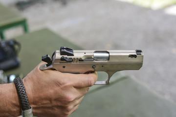 Man holding a gun ready to shoot