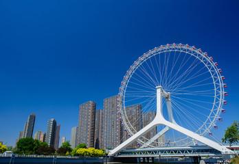 Cityscape of Tianjin ferris wheel,Tianjin eye in daytime.Popular landmark in Tianjin China. Papier Peint