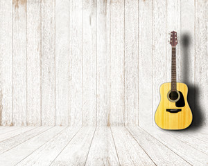 Acoustic guitar in vintage white wood room.