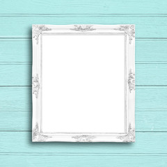 Classic white blank picture frame on blue wood wall.