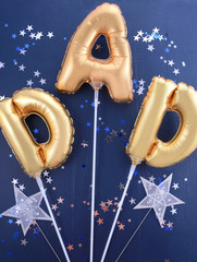 Fathers Day gold Dad balloons.