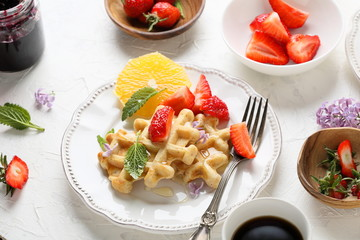 belgian waffles with berries and coffee