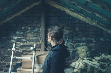 Young woman in derelict loft space