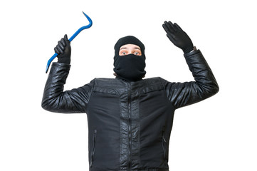 Burglar or thief is putting hands up. Arrested robber is giving up. Isolated on white background.