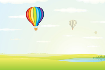 Hot Air Balloon over Green Fields. Image