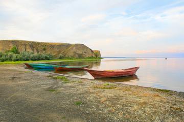 fishing boats at river bank Volga