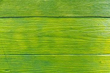 Green grungy wooden wall texture.