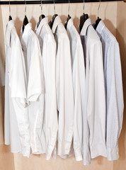 Men's shirts on hangers