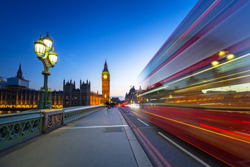 London scenery at Westminter bridge with Big Ben and blurred red bus, UK