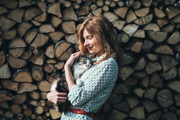 beautiful woman admires her wonderful cat