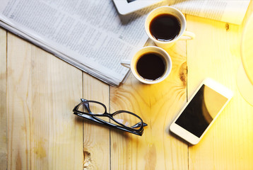 Black coffee with blank digital tablet and mobile phone, magazin