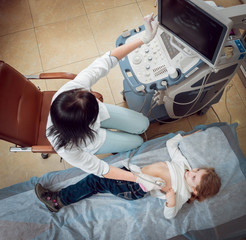 Doctor and little girl patient. Ultrasound equipment.
