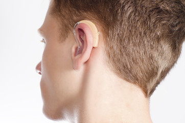 Teenager with hearing aid