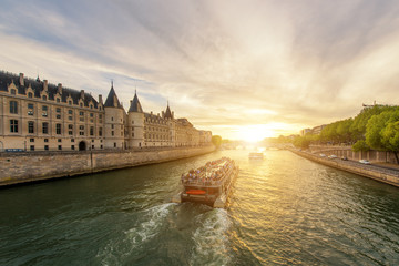 Boat tour on Seine river with sunset in Paris, France Wall mural