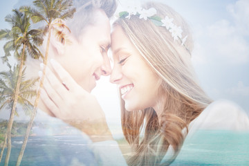 happy smiling young hippie couple over beach