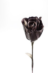black rose from palm leaf on white background