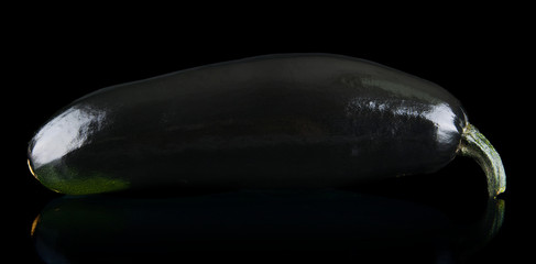 Black courgette on black background