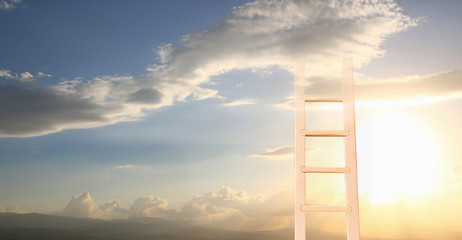 abstract image of ladder reaching into the sky
