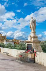 San Rafael statue of the Roman bridge in Cordoba - Spain