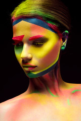Beautiful girl with creative variegated makeup. beauty face