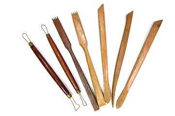 Carving tools, pottery white background
