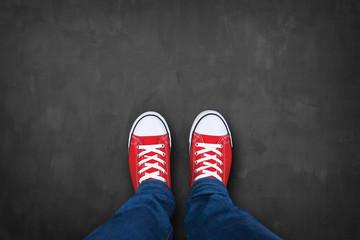 red sneakers on a chalkboard