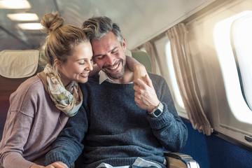 Mid adult couple on plane