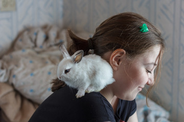 Girl with adorable little white rabbit
