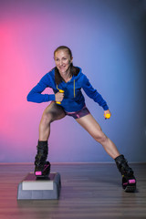 woman exercising with kangoo jumps shoes and stepper