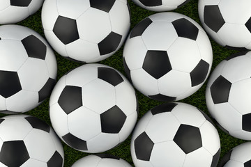 Soccer balls on grass background. Include clipping path.