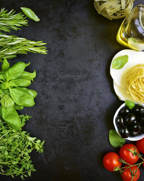 Traditional ingredients of italian cuisine on a black background