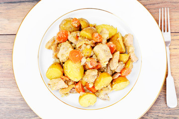 Stewed Quince with Potatoes, Carrots, Onions and Meat