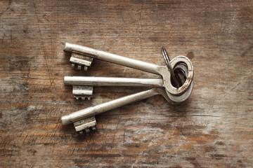 Old keys on wooden background