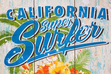 California super surfer print on a wall