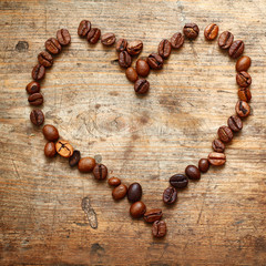 Coffe heart on old wooden background