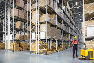 A worker in a huge distribution warehouse