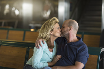 Mature couple kissing in passenger ferry