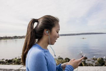 Woman using phone while jogging