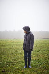 Boy standing in field