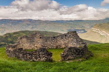 Remnants of a round house in Kuelap, ruined citadel city of Chachapoyas cloud forest culture in mountains of northern Peru.