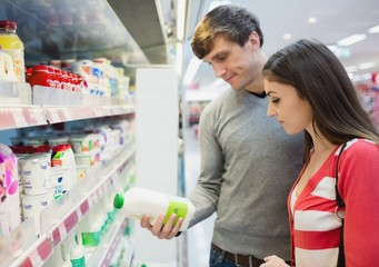 Profile view of couple doing grocery shopping