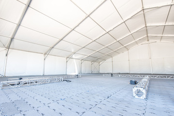 Large white tent for entertaining in field