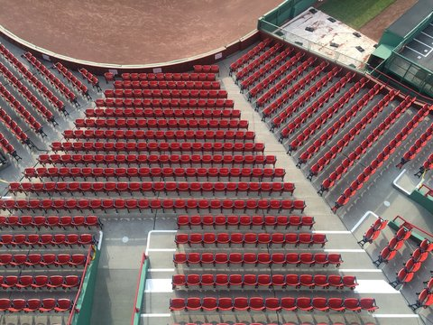 Rows of red seats at a baseball stadium